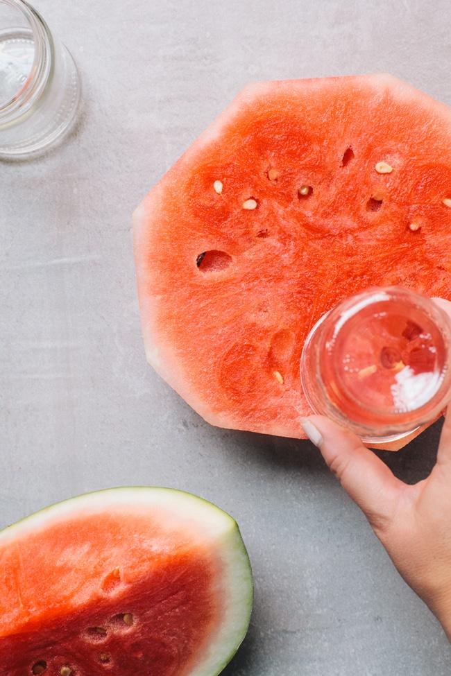 cut watermelon into cupcake shapes using a jar!