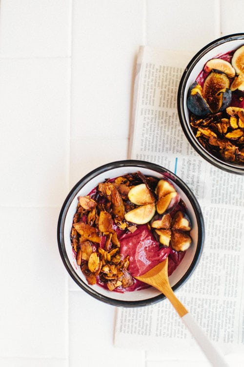 two bowls of purple blackberry acai frozen yogurt topped with olive oil granola crumble and figs