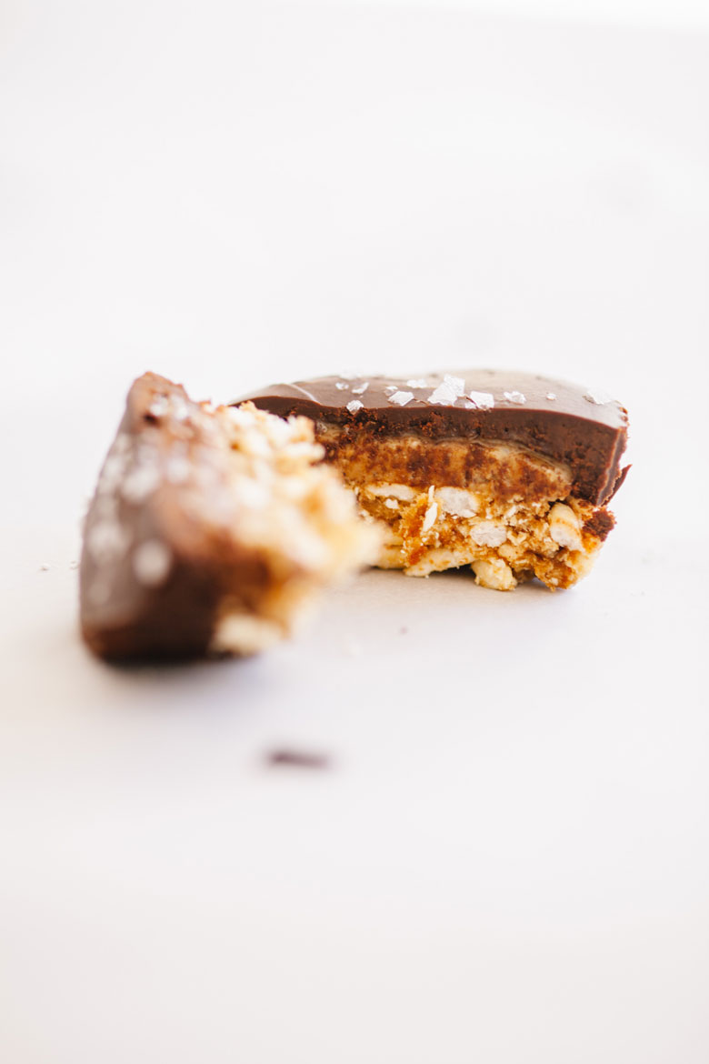 a Mint Chocolate Almond Butter Cup with Salted Oatmeal Crust cut in half