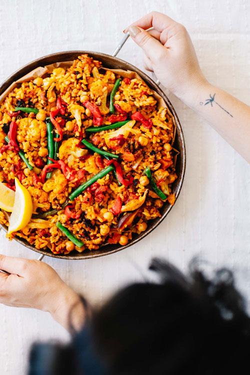 holding paella dish