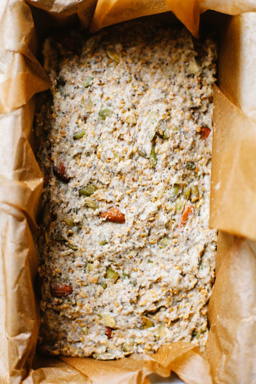 unbaked nut and seed loaf in a bread pan