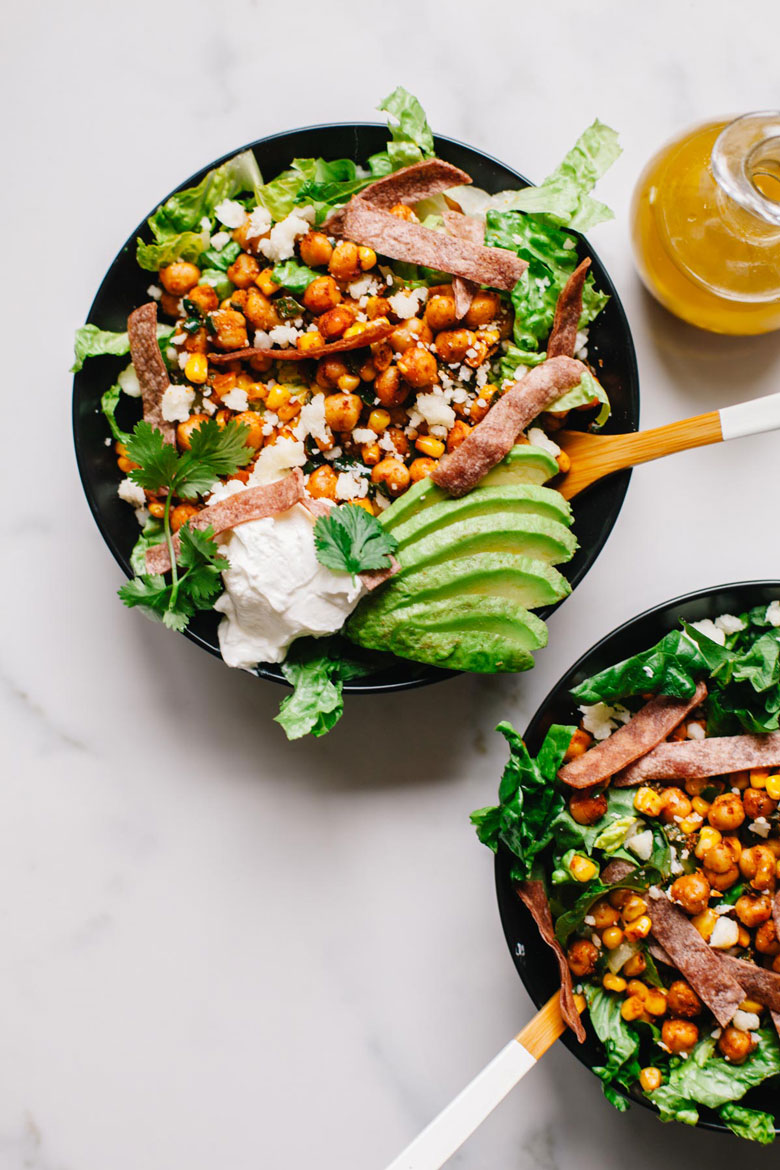 two bowls of Mexican chickpea and corn salad