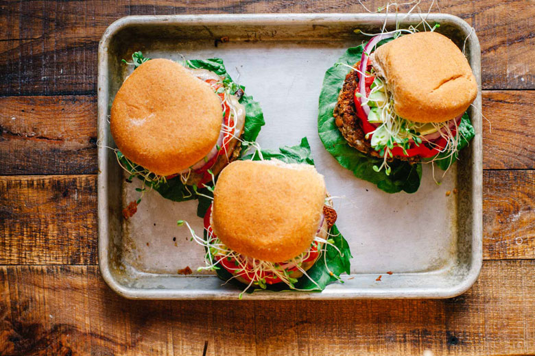 three veggie burgers on a tray