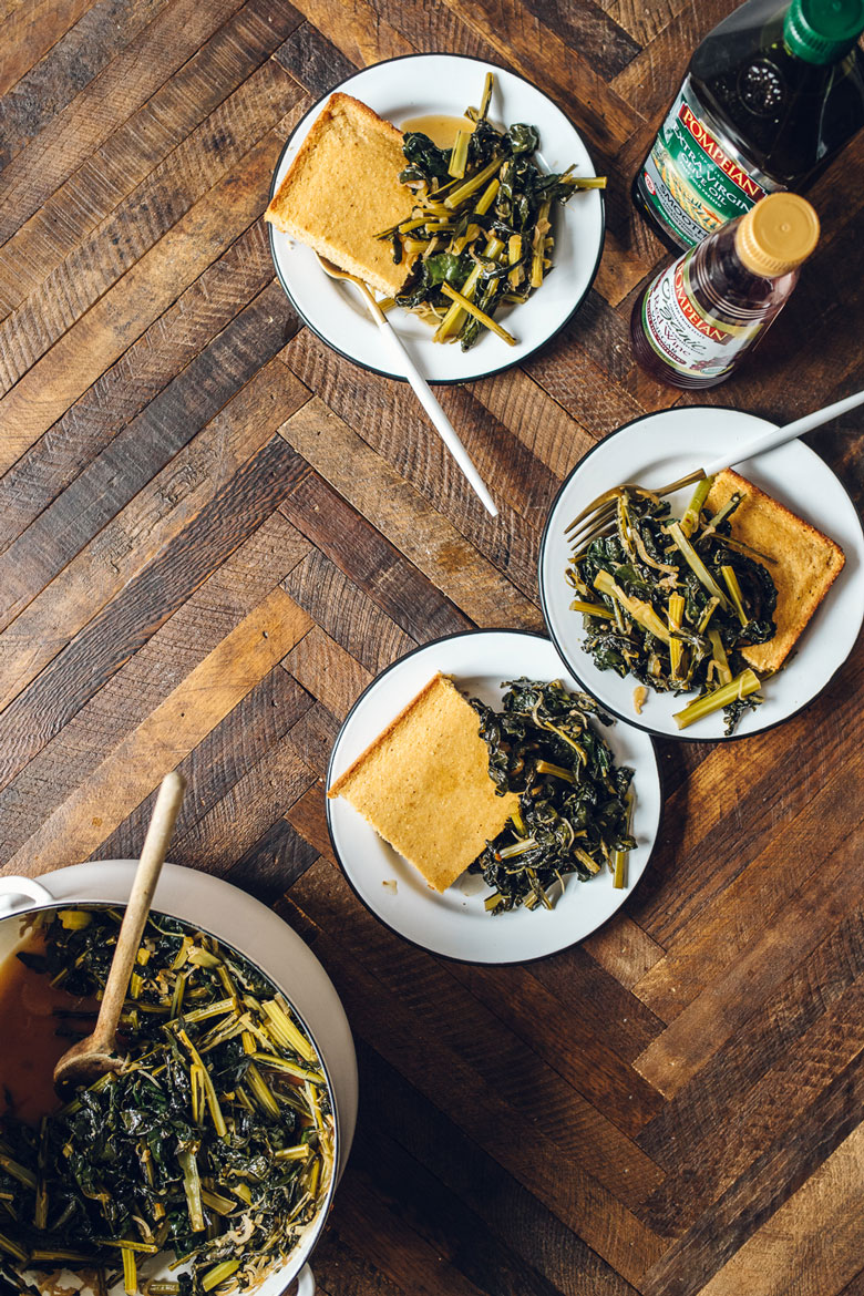 three plates of southern style dino kale with cornbread
