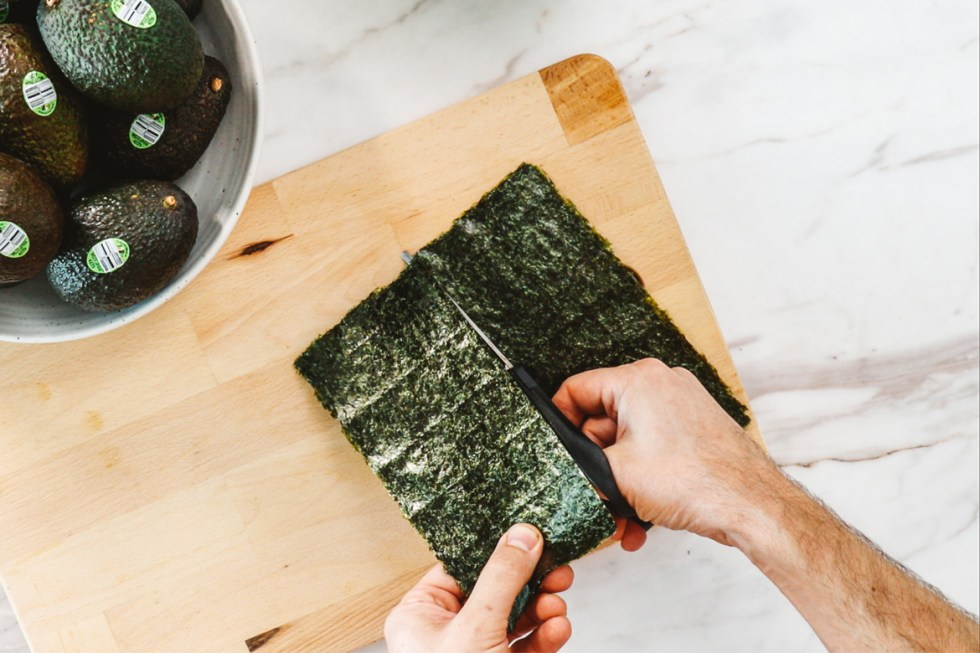 person cutting nori