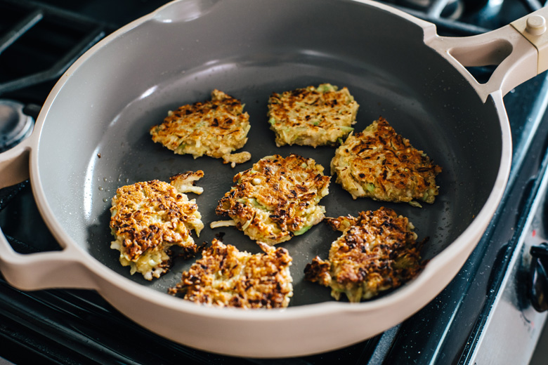 vegetable oat fritters in a pan on the stove