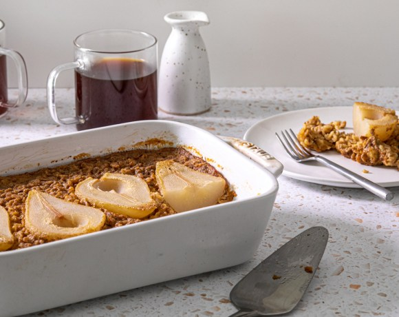 a baked oatmeal with pears on top