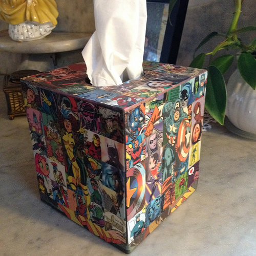 "In Sickness and In Health: A tissue box with Marvels ""The Avengers"" adorning it."