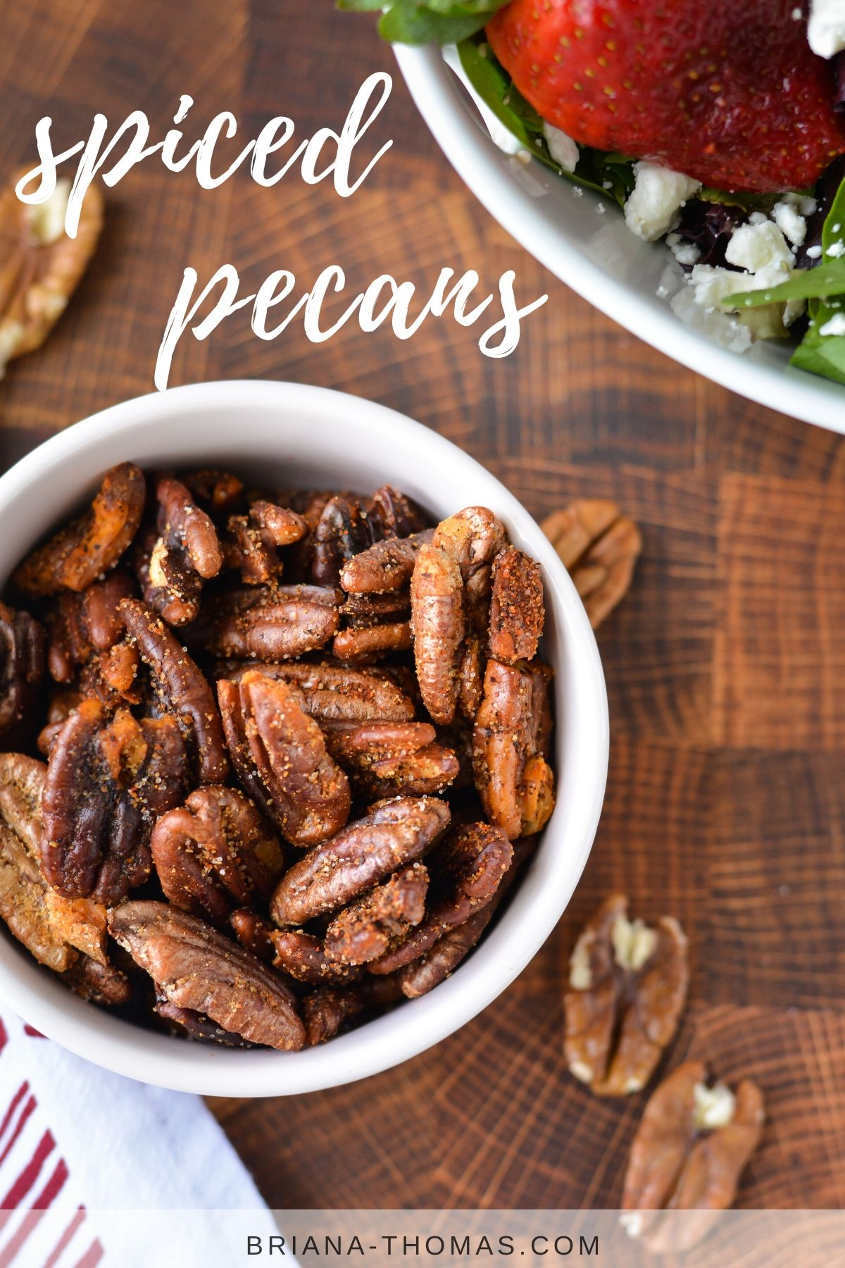 spiced pecans spilling out of a small bowl