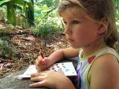 Katie Beth Working on her Habitats Badge for Wilderness Explorers