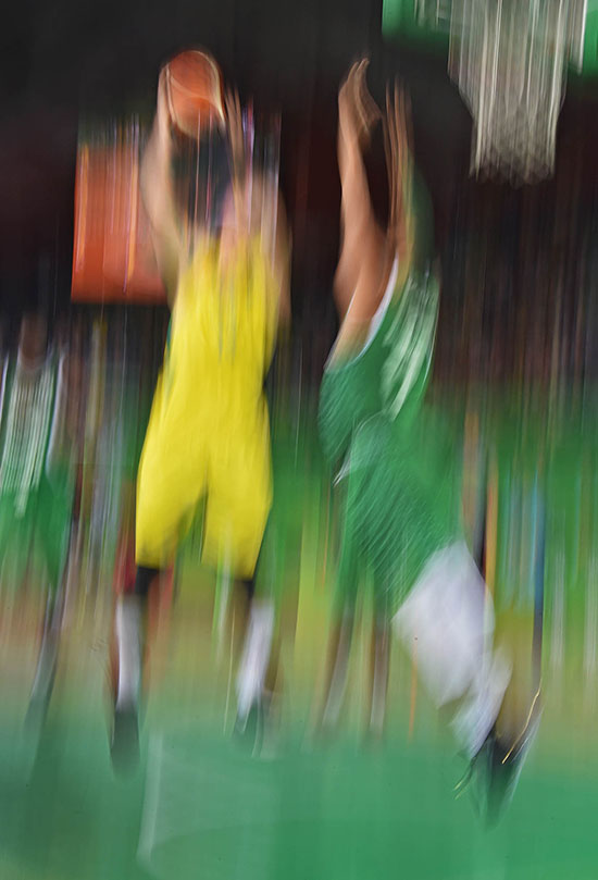 Australia's Angus Brandt (left) and Nigeria's Prince Orizu contest during the Men's Preliminary Round Pool A Basketball between Australia and Nigeria at the XXI Commonwealth Games Cairns, Australia. Image by Brian Cassey