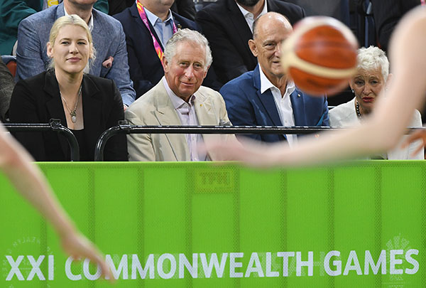 Britain's Prince Charles (with former Australian and WNBA basketball player Lauren Jackson to his right) during the India V New Zealand women's basketball game at the Commonwealth Games, Cairns - image by Brian Cassey