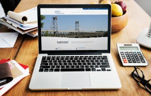 Wohlenberg Ritzman & Co website mocked up on a laptop.