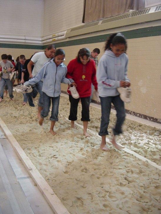 Kids walking through the mural