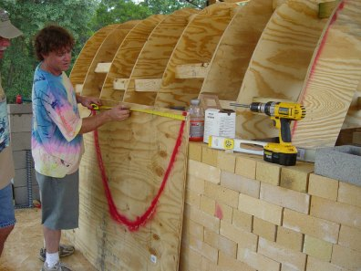 John Rezner working on arch form