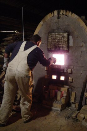 Wade Oliver stoking during the first firing