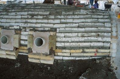 building insulation layer over hardbrick arch