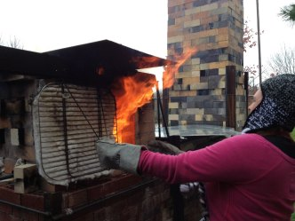 Meagan Plaiss firing the train kiln