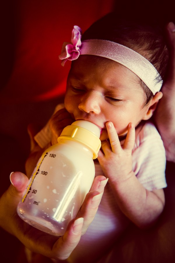 newborn being fed from bottle