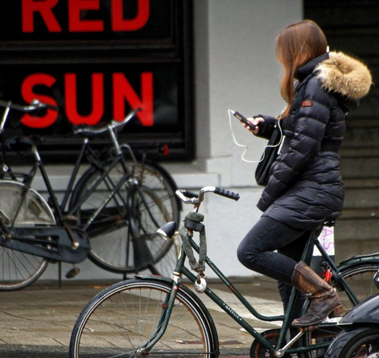 Girl on bike listending to iPhone read to her
