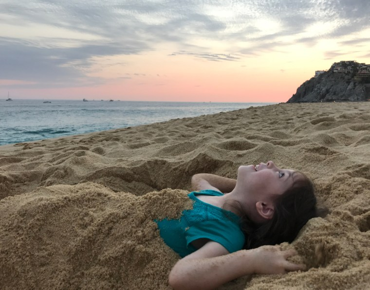 My Daughter Burred In Sand, Underneath the Clouds
