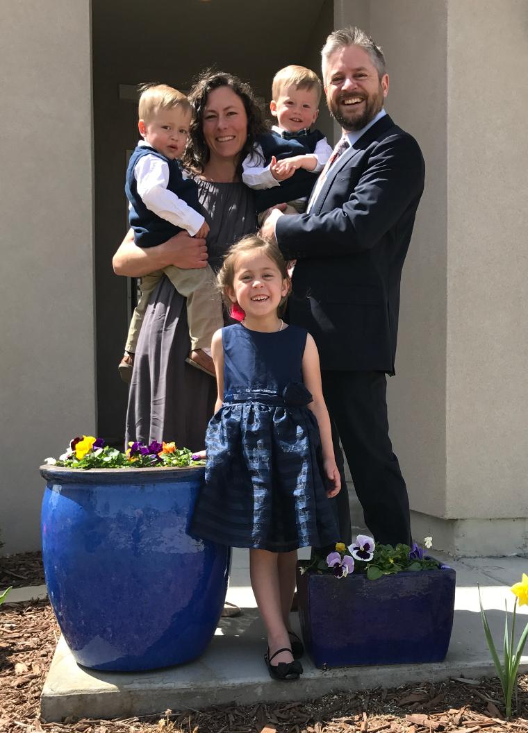 McAdam family outside near flowers