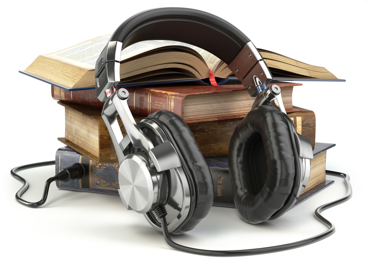 Headphones plugged into book