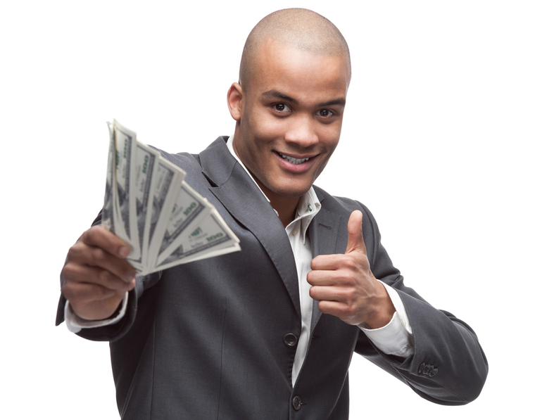 Man holding money and smiling, symbolizing his happiness