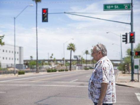 Lee Redding walks to the bus stop on Van Buren Street and 18th Street. He has to take a series of buses to get to a pharmacy to fill his 12 prescriptions.Redding, 57, came to wipe clean nearly $1,000 in traffic fines — some go back to 1996. Over the years, the fines added up and he couldn't afford the payments. Then the state suspended his license. Brian Rinker/The Republic