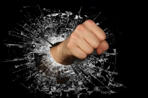 image of a fist punching through a window as a symbol of being mean