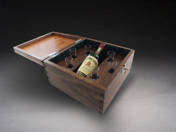 Open whiskey party box with six hot glasses