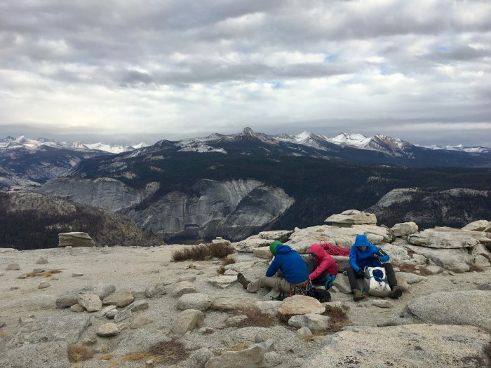 Eating some food and getting out of the wind for a bit after topping out on Half Dome