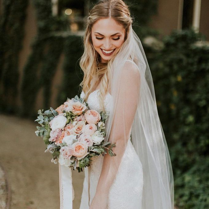 27 wedding hairstyles that work well with veils