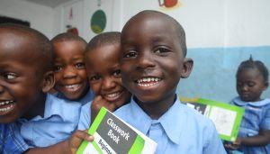 Liberian schools children smile to the camera