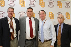 St. Joseph High School Administration Welcomes Coach Dudzinski. Pictured L to R: Dr James Keane, Principal; Coach Paul Dudzinski; Mr. Kevin Butler, Vice Principal for Athletics and Dr. William Fitzgerald, President.