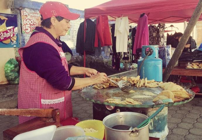 Lady making breakfast tacos