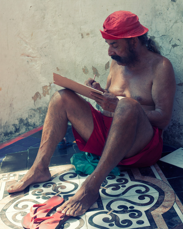 Selaron painting on his steps in Rio