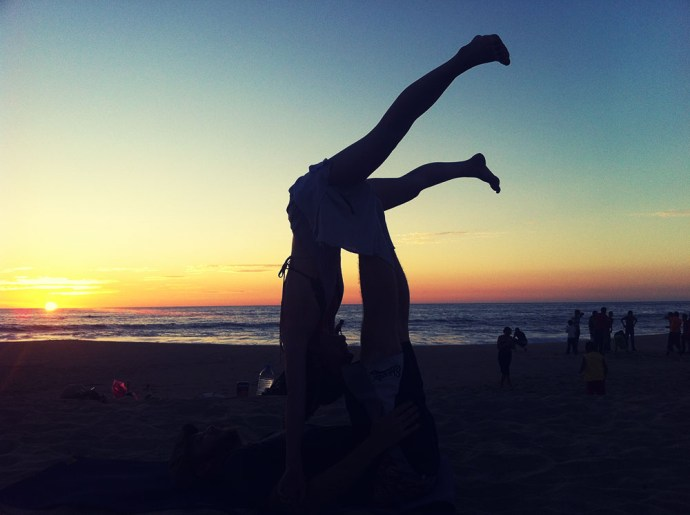 Upside acro yoga at sunset