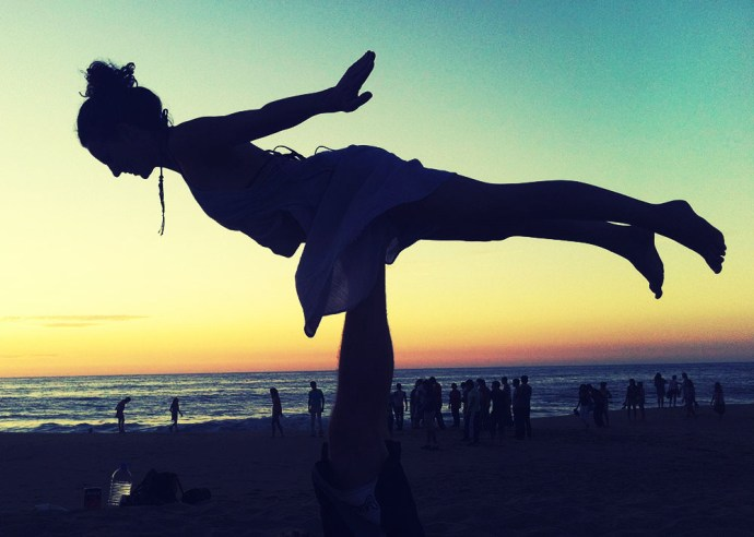 acro yoga at sunset
