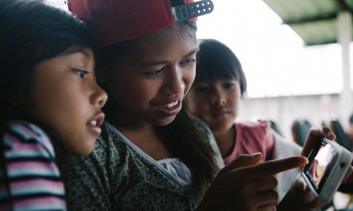Girls looking at iPhone photos