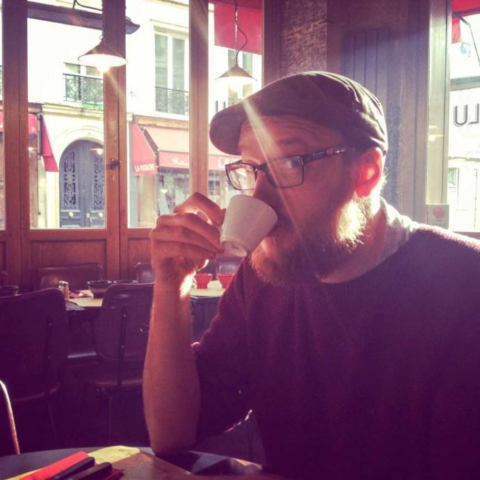 Steve drinking coffee in Paris