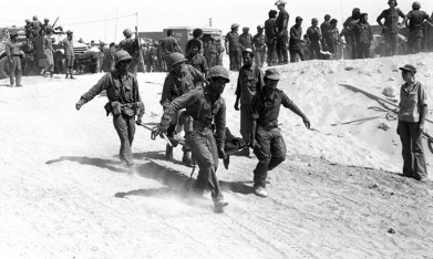 On the Yom Kippur of October 6, 1973, Egypt and Syria launched a coordinated surprise attack on Israel. The Yom Kippur War was launched on the holiest day on the Jewish calendar: The Day of Atonement.The Israel Defense Forces suffered 2,297 casualties and more than 7,200 soldiers were injured. Pictured here is an IDF medical crew evacuating an injured soldier from the battle field.