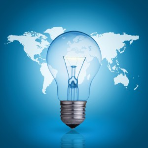 light bulb on blue background world map