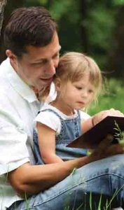 Father and daughter reading the Bible