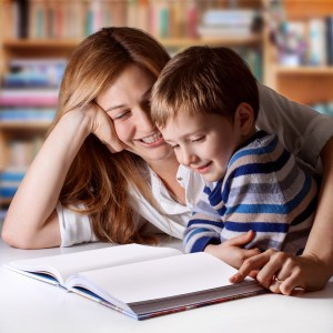 Mother reading Bible stories to her boy-178596770