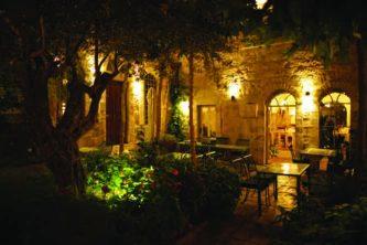 American Colony Hotel patio at night