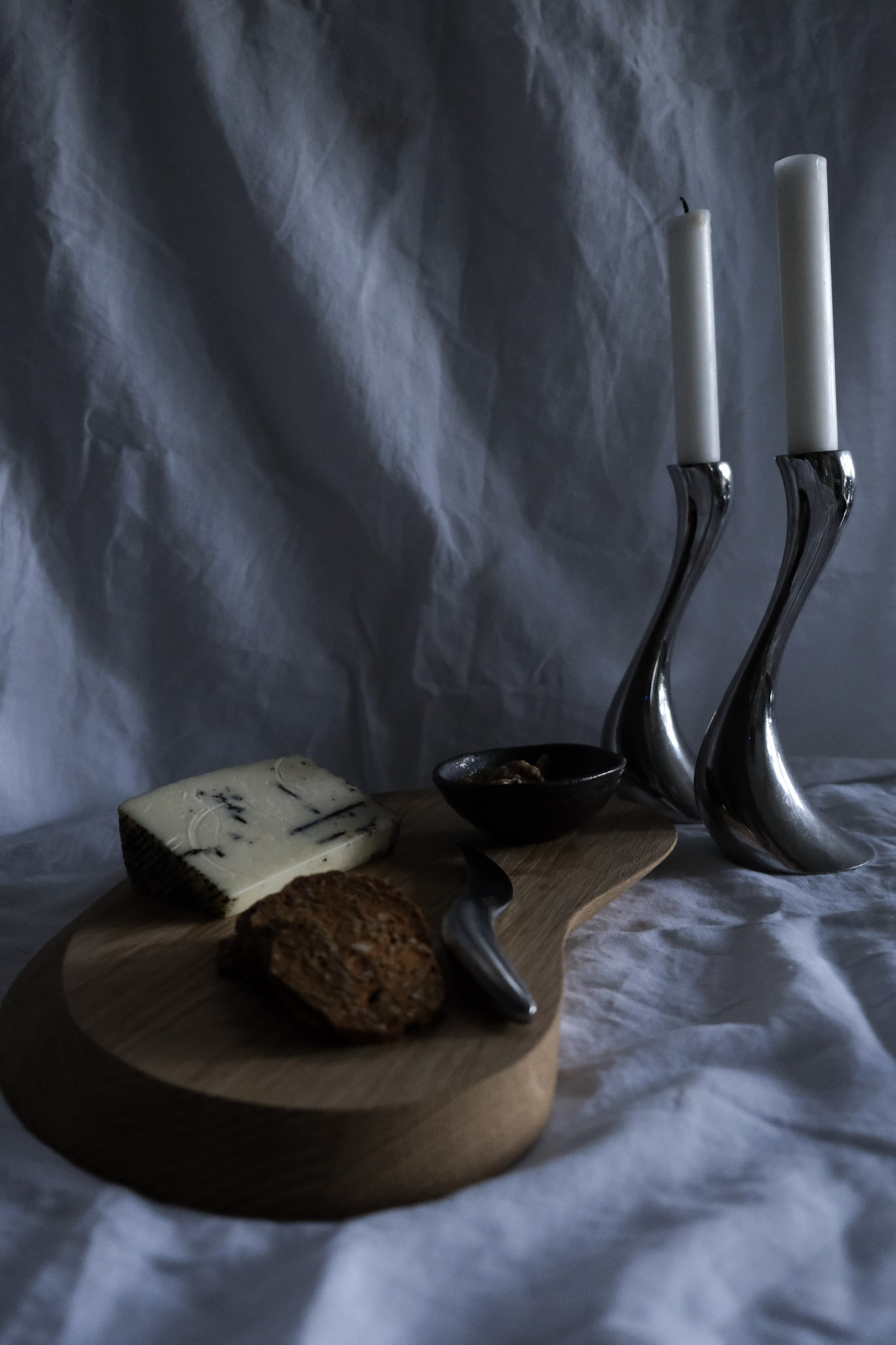 September monthly moodboard, George Jensen cheeseboard and candle holders with truffle percorino cheese and crackers