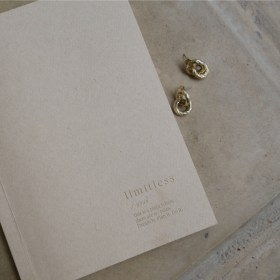Routines, an organised life notebook and gold hoop earrings