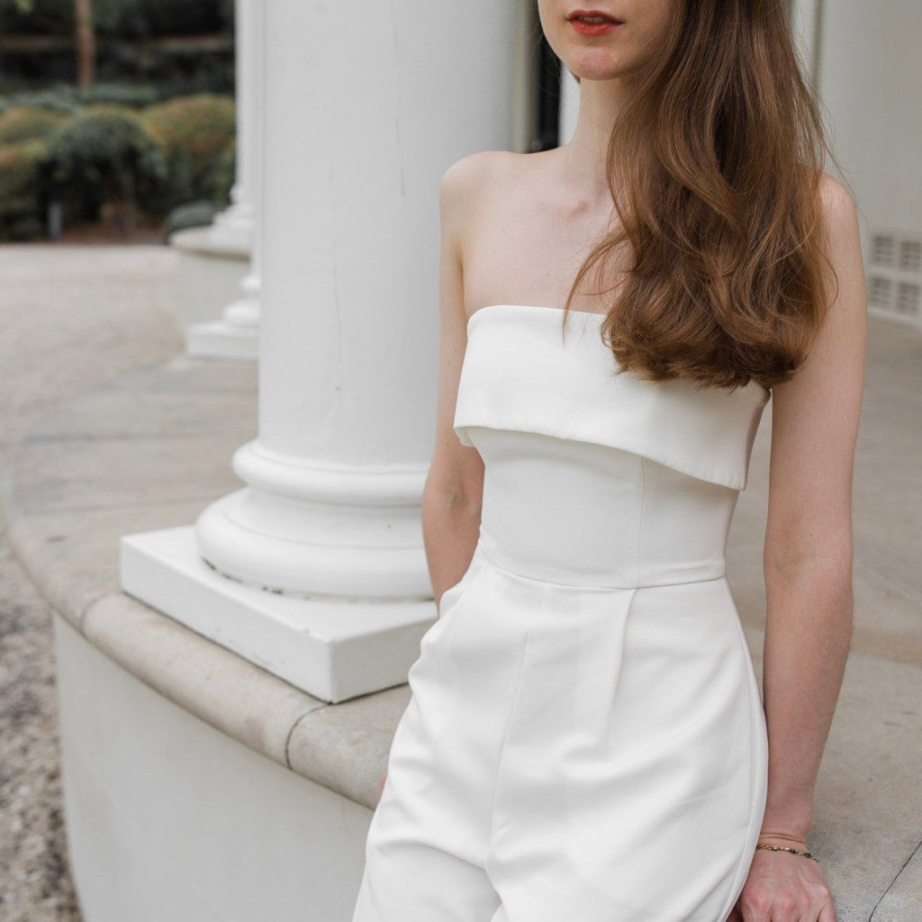 Girl wearing a white Forever New jumpsuit standing on the steps of Tempe House, Sydeny. Minimalist wedding ideas, minimalist engagement outfit inspiration, Engagement outfit ideas, bridal shower outfit ideas, slow fashion, asking why before you buy, conscious fashion, slow fashion blogger