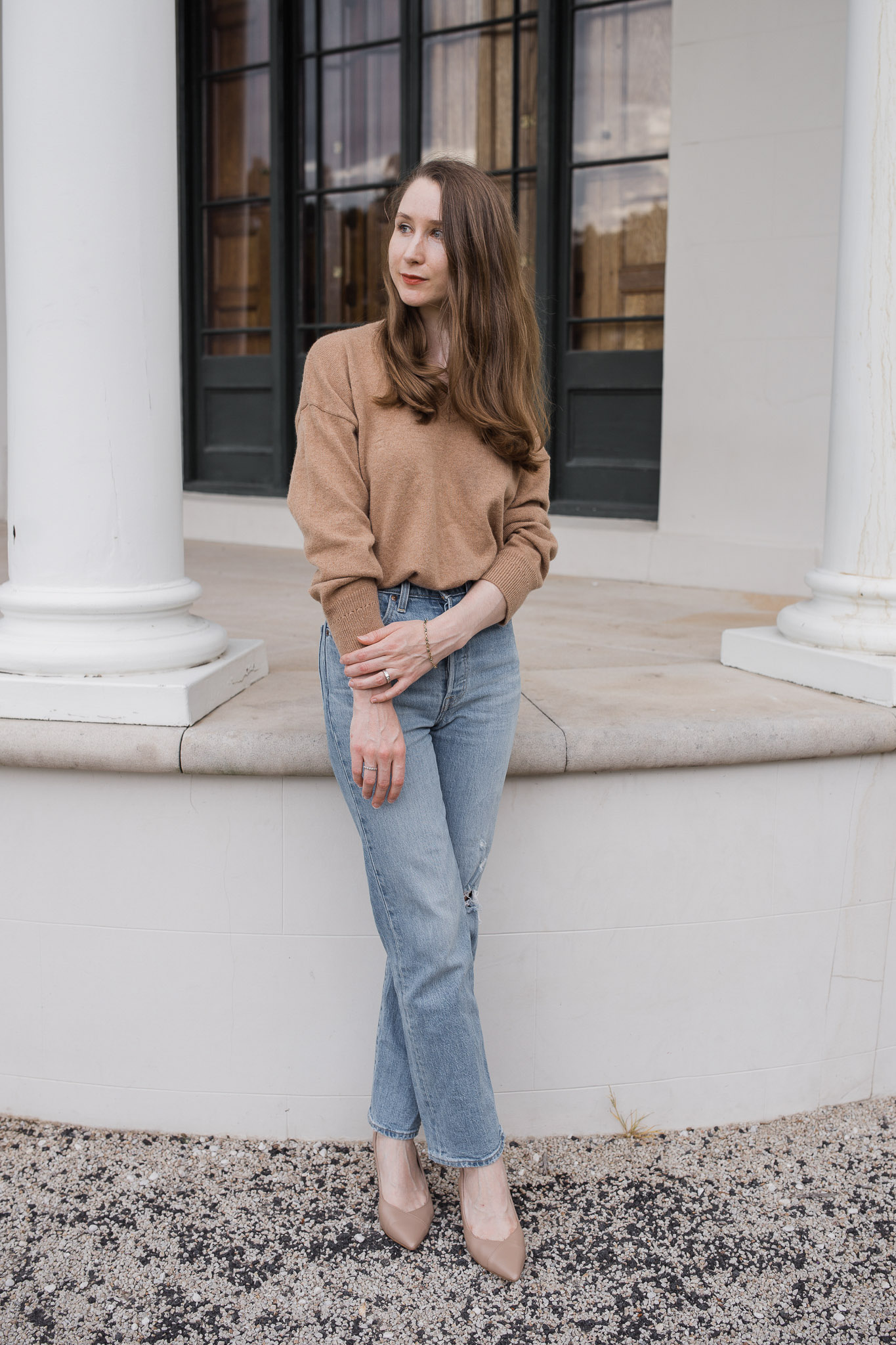 Girl wearing a brown oversized sweater and Levi's ribcage straight ankle jeans in front of Tempe House, Sydney. Minimalist style inspiration. Winter fashion outfit ideas. How to style knitwear. Capsule wardrobe inspiration